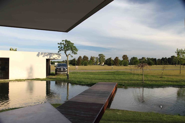 Casa Orquidea: Casas de estilo moderno por Remy Arquitectos