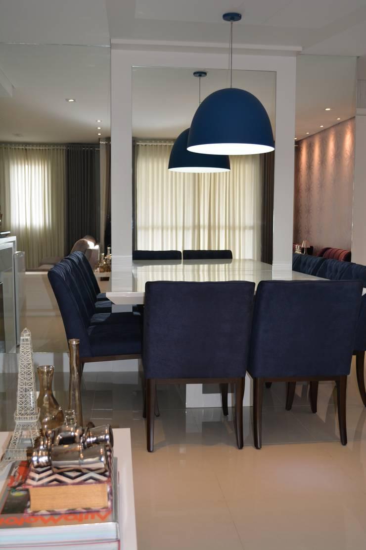 APARTAMENTO 143: Salas de jantar  por ViKasa arquitetura e interiores