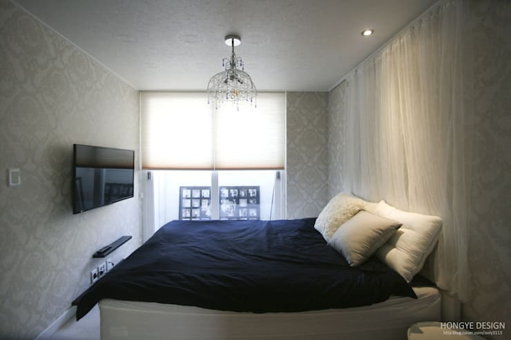 파스텔톤의 따뜻한 신혼집 _ 33py: 홍예디자인의  침실