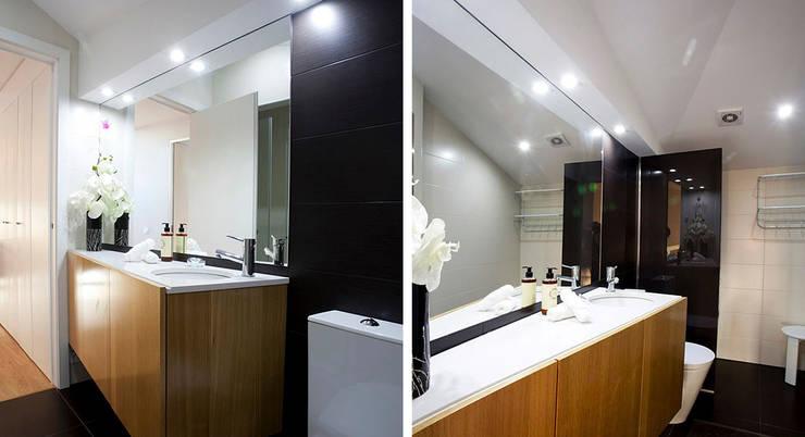 Edifício habitacional: Casas de banho ecléticas por Alves Dias arquitetos