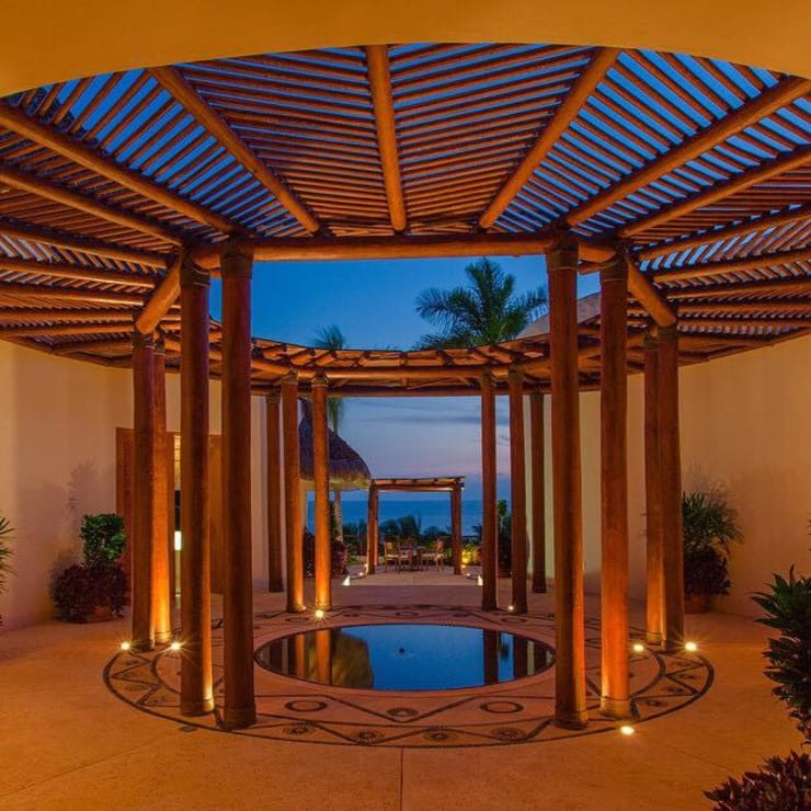 Casa Caracol: Paredes de estilo  por BR  ARQUITECTOS, Tropical