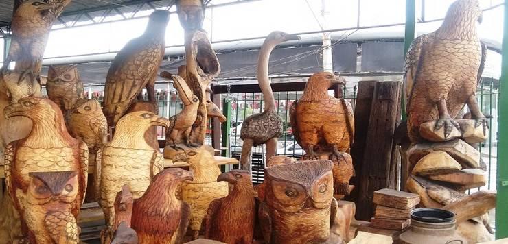 Esculturas em Madeira: Jardim  por O Quintal do Vovô