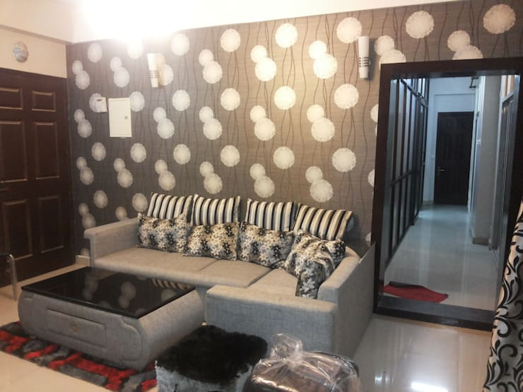 Ajnara Residential Apartment.:  Living room by Decor At Door