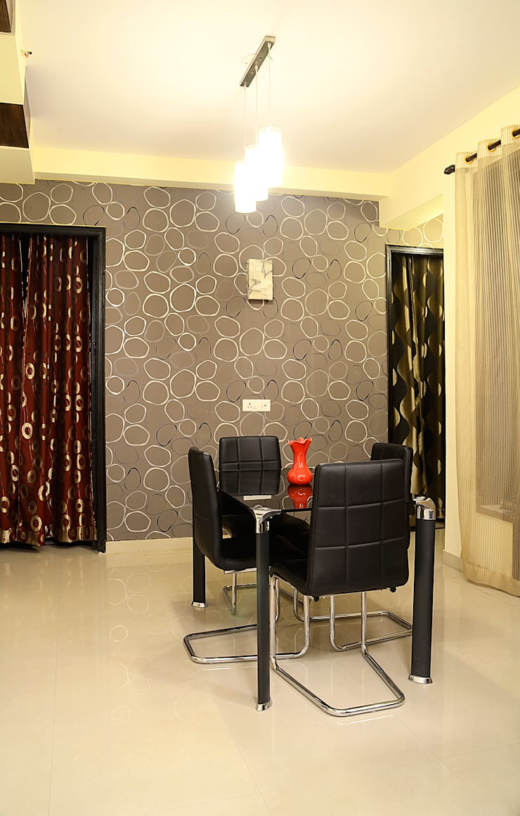 Arihant Ambience Apartment.:  Dining room by Decor At Door