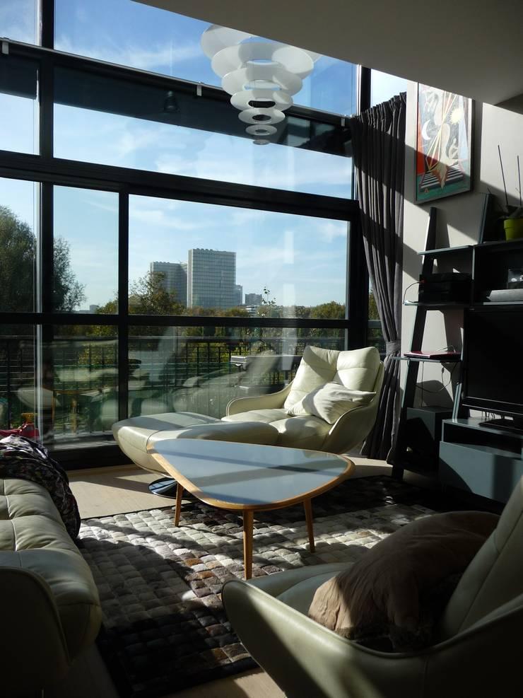 Duplex Parc de Bercy: Salon de style  par AADD+