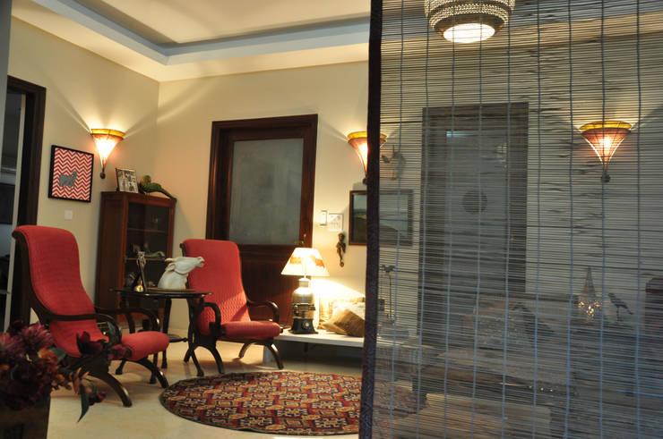 Apartment:  Living room by monica khanna designs