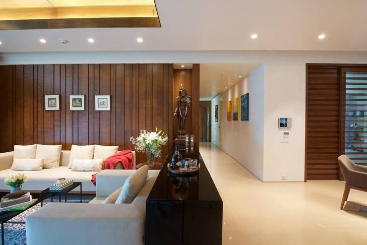 AVS Apartment :  Living room by Atelier Design N Domain