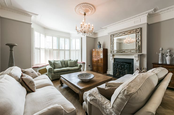Full renovation on Trinity Road, London:  Living room by Grand Design London Ltd