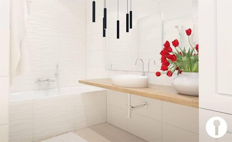 Rodzinne wnętrza: styl , w kategorii Łazienka zaprojektowany przez Urządzamy pod klucz