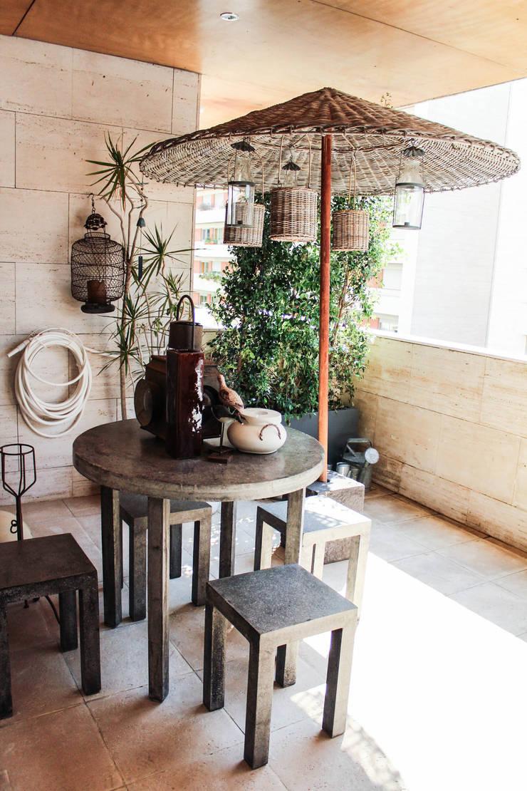 Casa particular: Terraços  por Gavetão- Decoração de Interiores