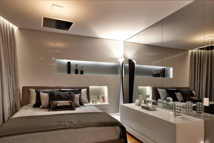 Apartamento P.P.N.R: Quartos  por Bellini Arquitetura e Design