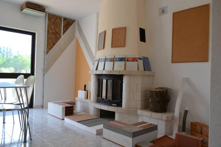 Showroom Eclectic style living room by RenoBuild Algarve Eclectic