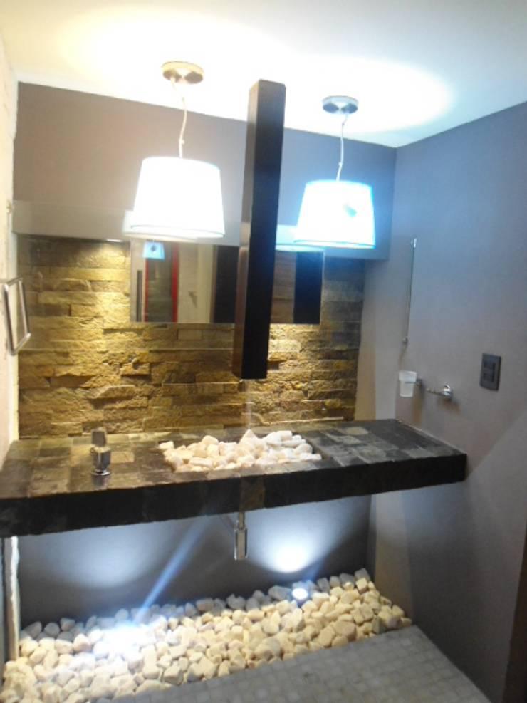 baño compartido: Baños de estilo  por bello diseño!