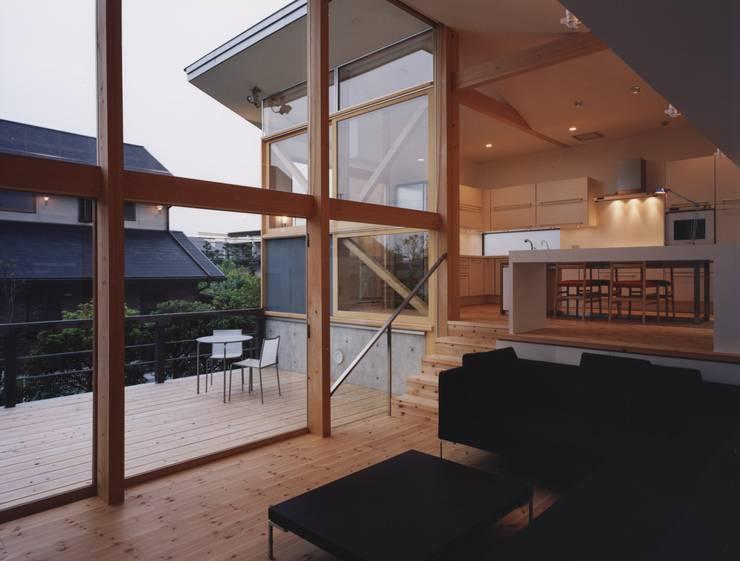 新千里南町: 伊東建築計画室が手掛けたリビングです。,