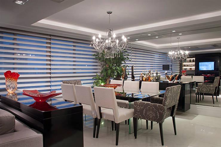 Sala Estar /Jantar Apartamento 1: Salas de jantar  por Angela Ognibeni Arquitetura e Interiores