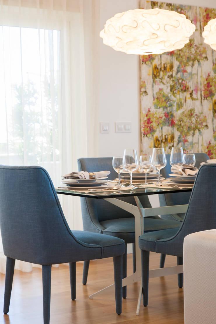 Sala Comum_pormenor da zona de jantar : Salas de jantar  por Traço Magenta - Design de Interiores