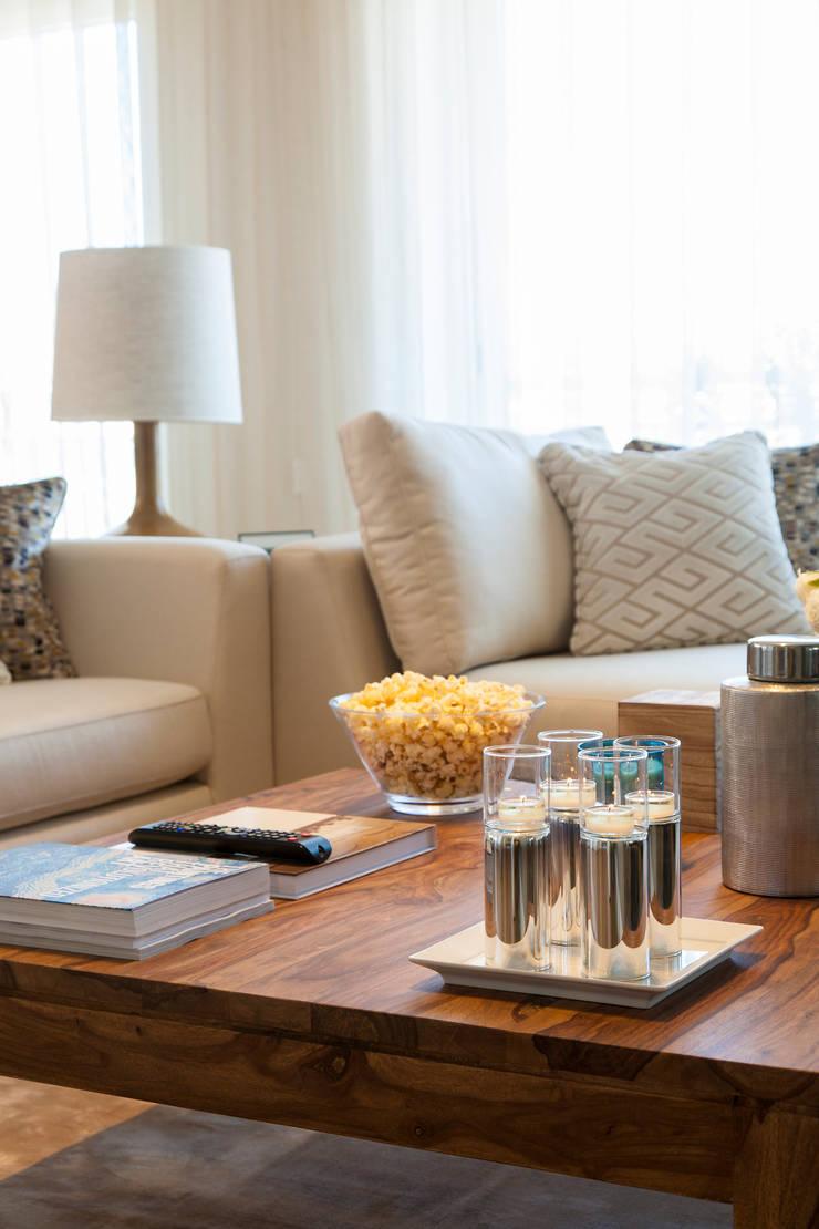 Sala Comum_pormenor da zona de estar: Salas de estar  por Traço Magenta - Design de Interiores