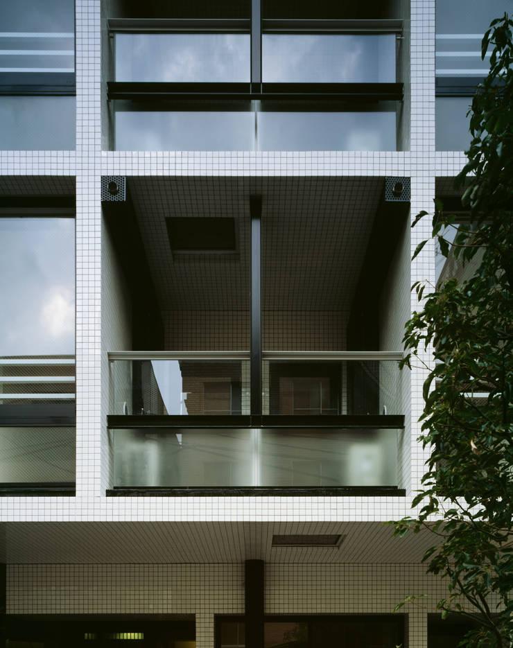 プラザレジデンス8: 片岡直樹設備設計一級建築士事務所が手掛けた家です。,モダン