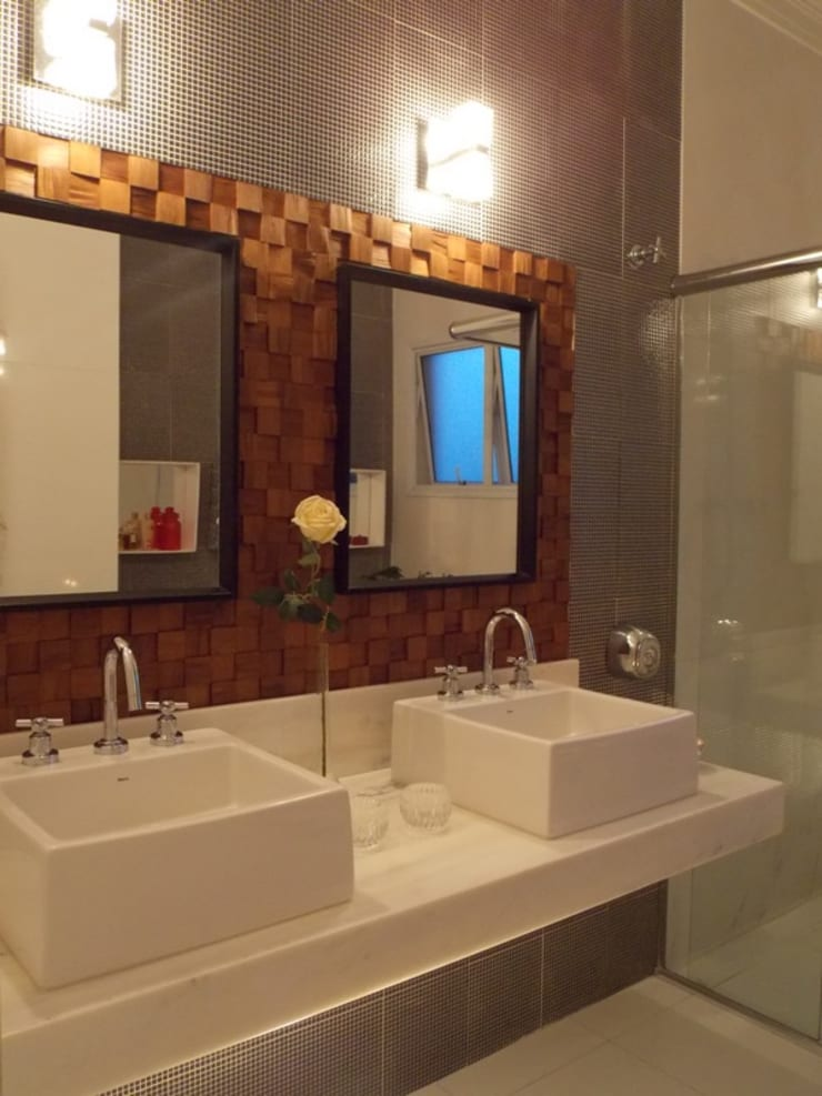 Bancada dupla: Banheiros  por Lúcia Vale Interiores,