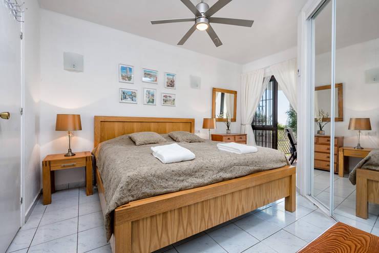 Detalle de dormitorio: Dormitorios de estilo ecléctico de Espacios y Luz Fotografía