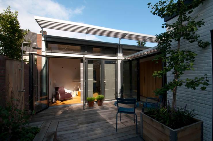 Casas de estilo  por JANICKI ARCHITECT