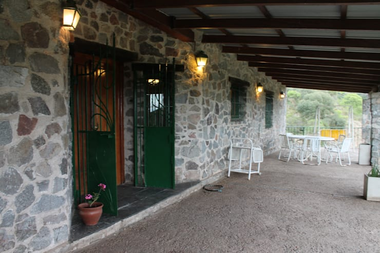 Terrazas de estilo  por Casas de Campo