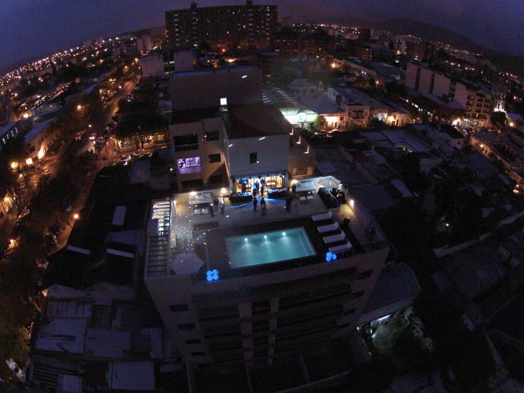 El Edificio Leguizamon 979 Visto desde el aire: Terrazas de estilo  por Proyecto Norte