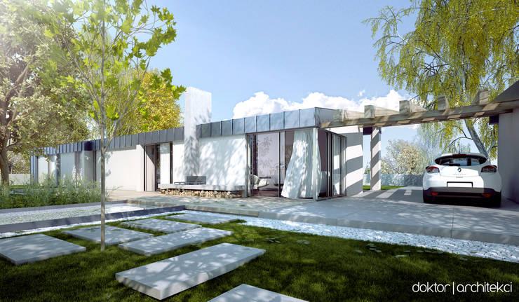 DOM DLA OSOBY NIEPEŁNOSPRAWNEJ - widok od ogrodu: styl , w kategorii  zaprojektowany przez DOKTOR ARCHITEKCI