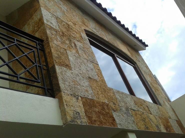 Casa JdC: Casas de estilo  por PUNTO A PUNTO ARQUITECTURA