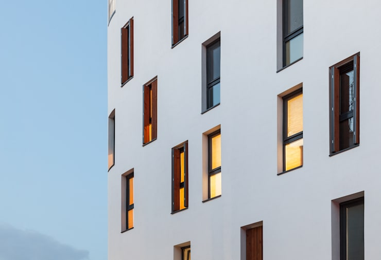 Woonam Urban Housing: Strakx associates 의  주택,모던