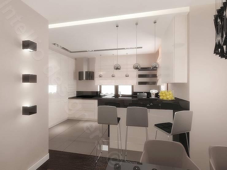 Otwarta kuchnia: styl , w kategorii Kuchnia zaprojektowany przez Intellio designers,Nowoczesny