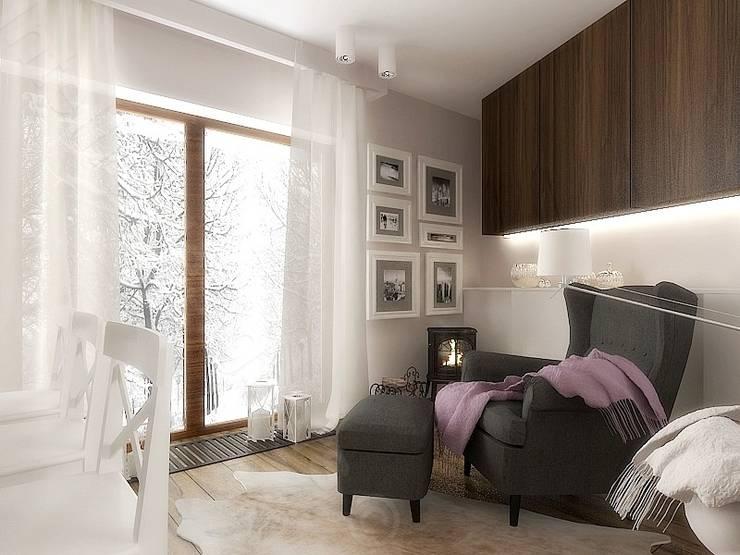 Aranżacja komfortowego salonu: styl , w kategorii Salon zaprojektowany przez Intellio designers,Nowoczesny
