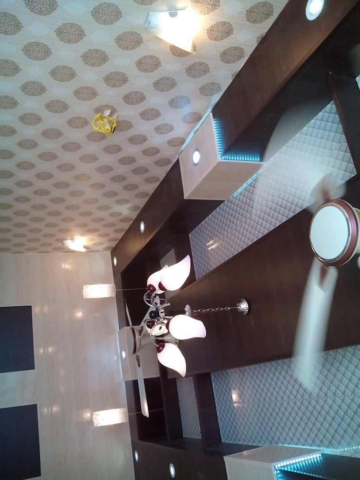 Ceiling and wall designing using pvc wall panels, wallpaper and led lights etc..:  Study/office by Mohali Interiors