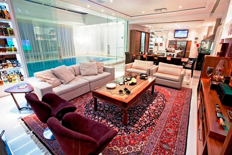 Salão Integrado: Salas de estar  por Ariane Labre Arquitetura