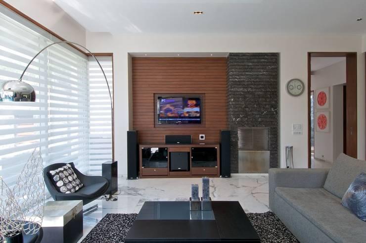 NP Villa:  Living room by Atelier Design N Domain