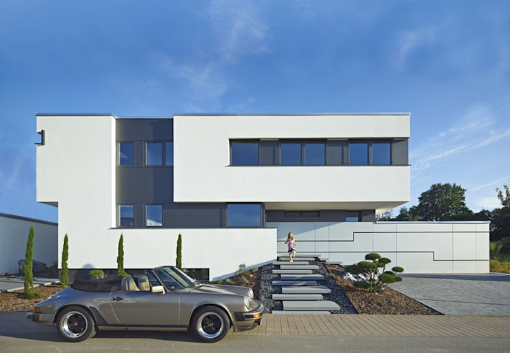 Casas modernas por LEE+MIR