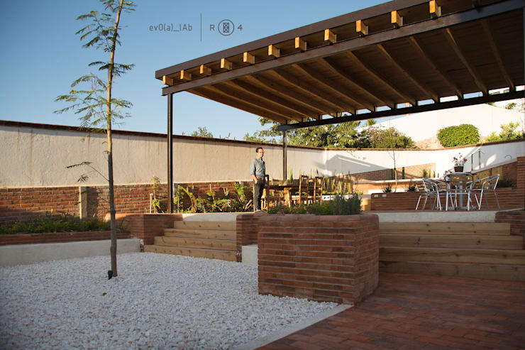Jardín y techo: Jardines de estilo  por Región 4 Arquitectura