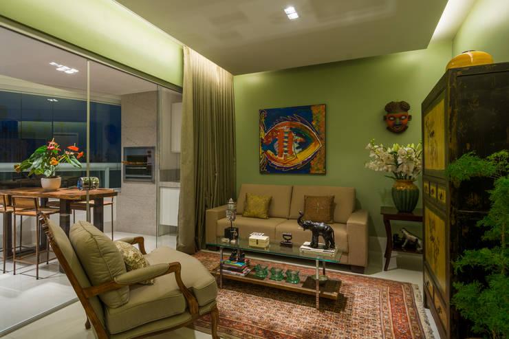 Apartamento Santo Agostinho: Salas de estar  por Melina Mundim | Design de Interiores,
