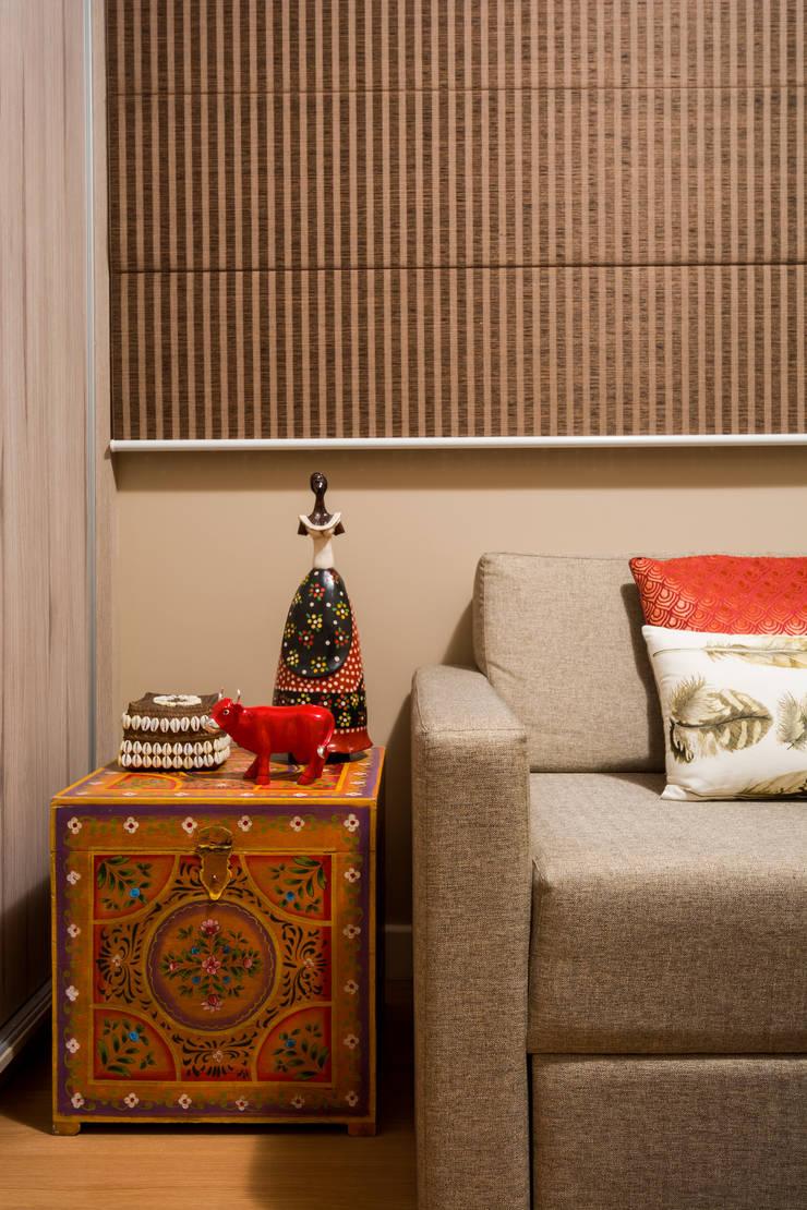 Apartamento Santo Agostinho: Salas multimídia  por Melina Mundim | Design de Interiores,