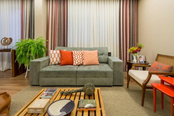 Apartamento Villa Paris: Salas de estar  por Melina Mundim | Design de Interiores