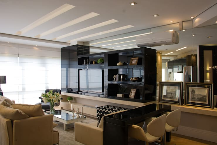 Projeto com toques masculinos para um jovem solteiro: Salas de estar  por marli lima designer de interiores