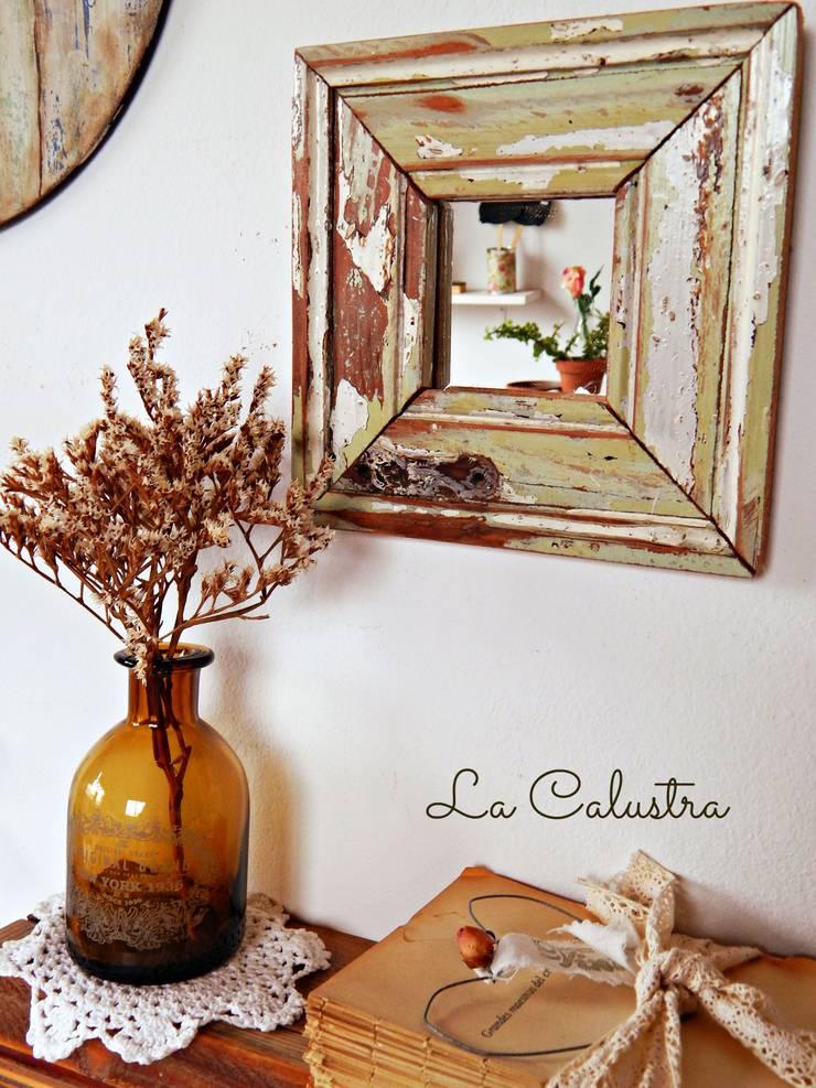 El encanto de las maderas recuperadas: Hogar de estilo  por Tienda La Calustra,
