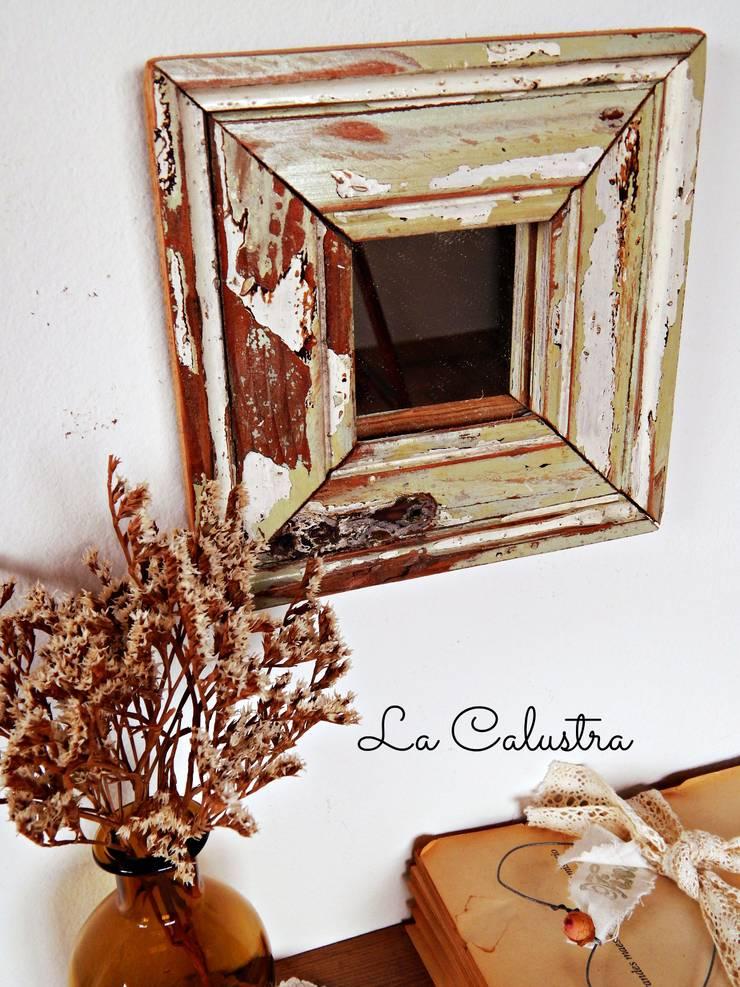 El encanto de las maderas recuperadas: Hogar de estilo  por Tienda La Calustra