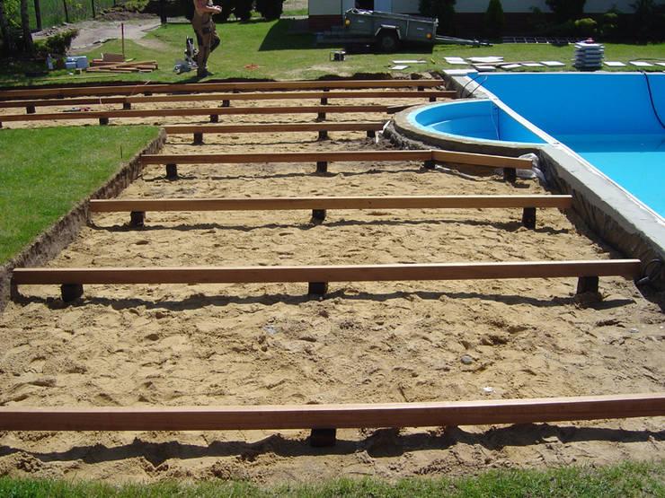 Taras drewniany przy basenie. Realizacja w Polkowicach.: styl , w kategorii  zaprojektowany przez PHU Bortnowski