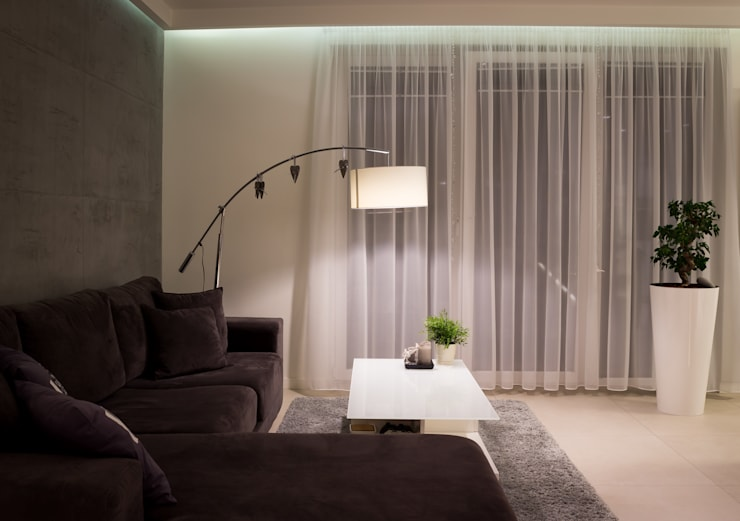 Salones de estilo  de Architekt Adam Wawoczny