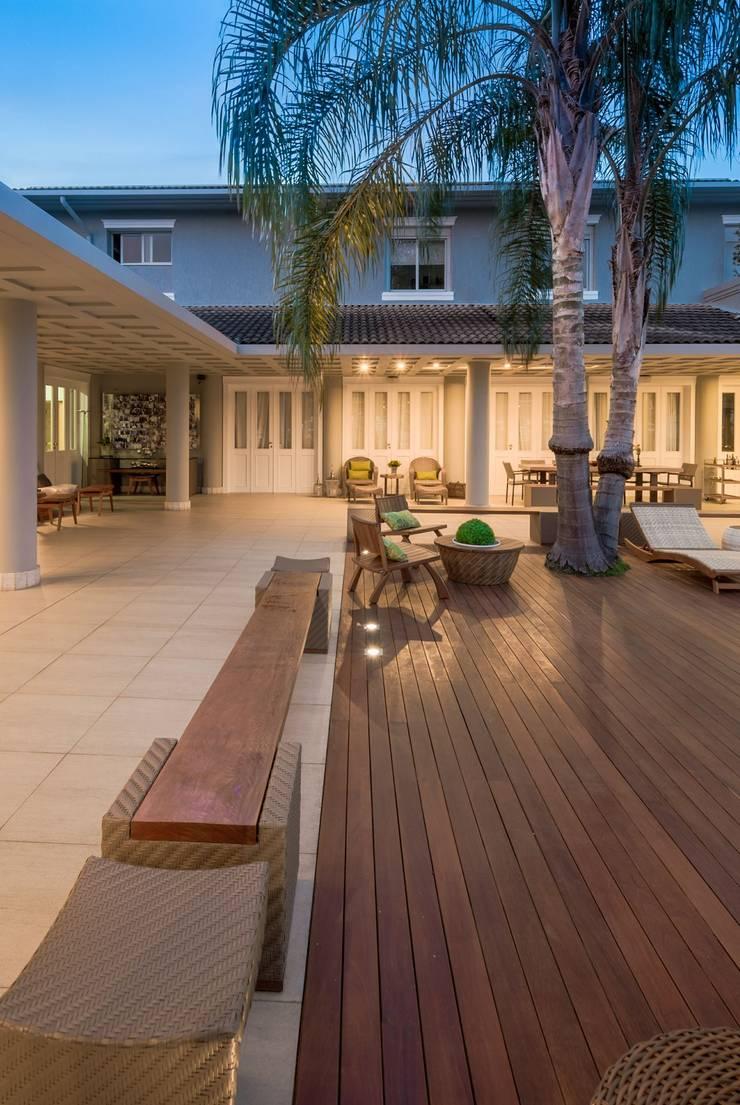Varanda Gourmet: Terraços  por MMMundim Arquitetura e Interiores