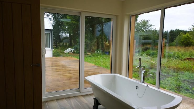 Free standing bath with a view:  Bathroom by Architects Scotland Ltd