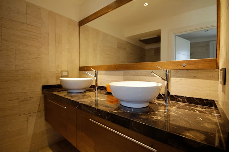 Baños de estilo  por MiD Arquitectura