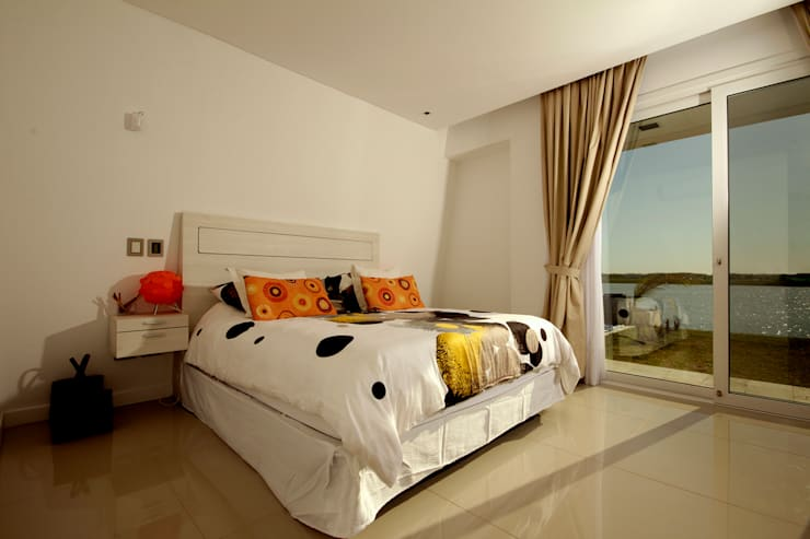 Casa MaLi: Dormitorios de estilo  por MiD Arquitectura