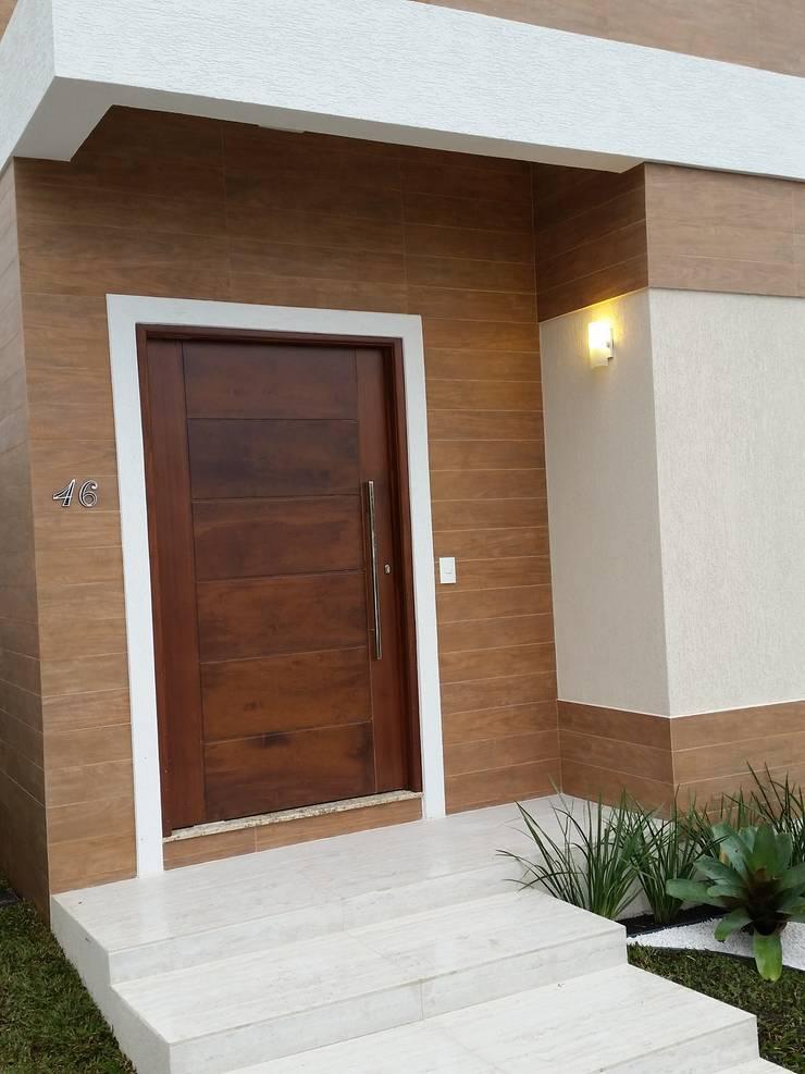 RJH: Casas  por Angelica Pecego Arquitetura,Eclético